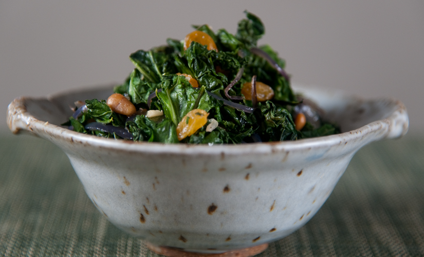 Kale with pine nuts and golden raisins